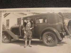 Undated, unidentified woman with car.